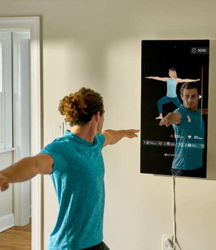 a man workouts with the Reflect Touch
